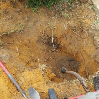 Digging to locate the buried sewer inspection shaft so I can fix the blocked drain